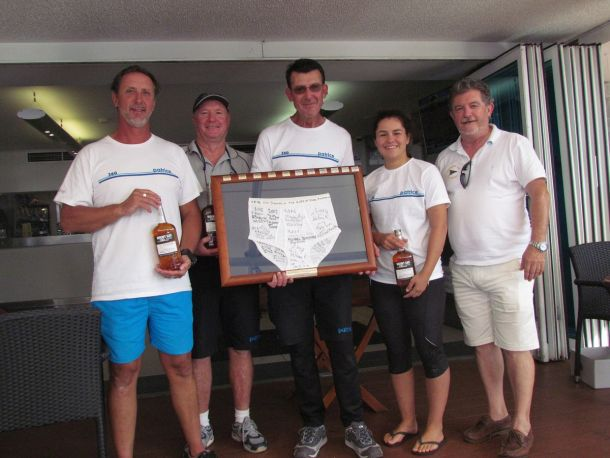Winner Tony Kirby (holding Mt Gay Top Jocks trophy) and crew with CYCA Director