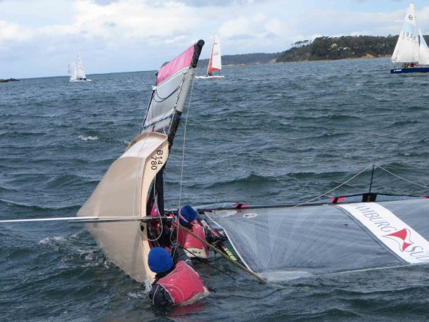 Richie and Lissa Reynolds from Woollahra Sailing Club capsize. Photo credit Lachlan Brown.