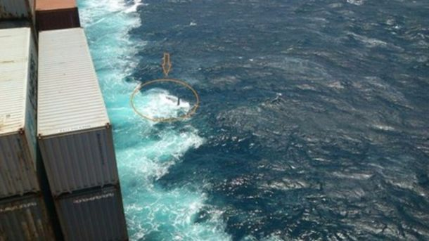 The upturned hull of the Cheeky Rafiki spotted from a container ship Credit: ITV News