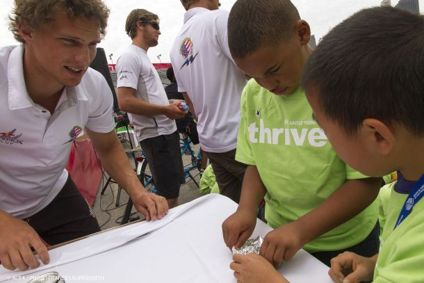 America's Cup sailors helping local youth. Photo © ACEA / Frances Kupersmith.