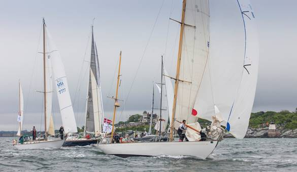 A fleet of 13 boats took off for England today from Newport
