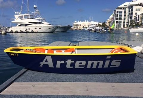 The repaired Optimist dinghy resplendent in Artemis blue and yellow. Photo Royal Gazette.