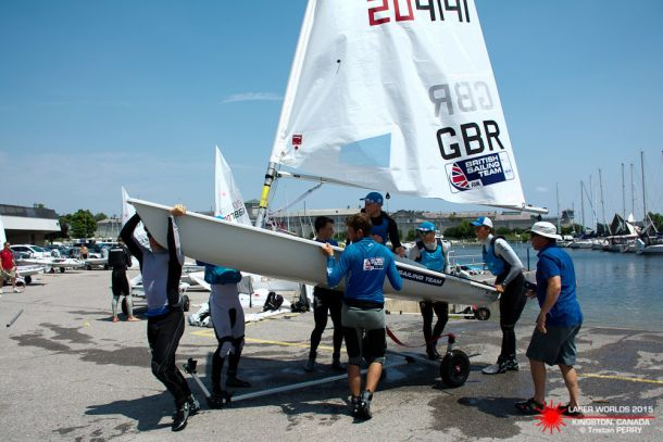 Nick Thompson is carried up the ramp by teammates after winning the Laser Worlds. Photo Sailingshot.