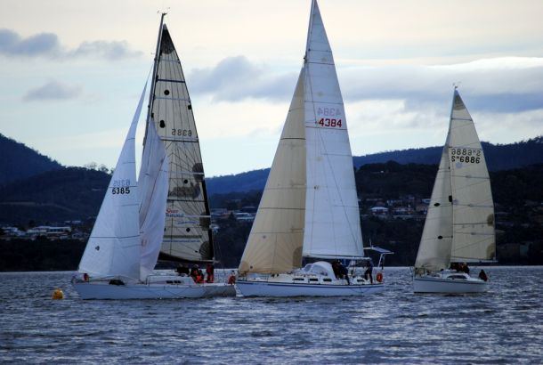Winstead Wines leads First Light and Young Lion around the leeward mark off Nutgrove Beach. Photo Peter Campbell.