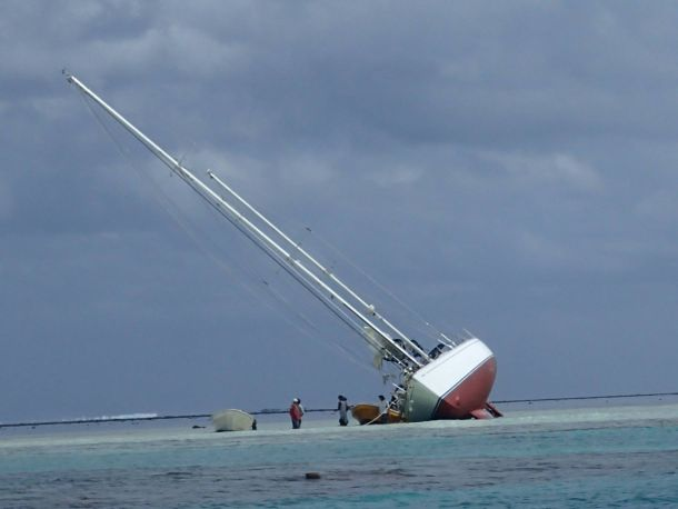 The Swan 57 on it's side on the reef off Musket Cove in Fiji. Photo Jack Hargraves.