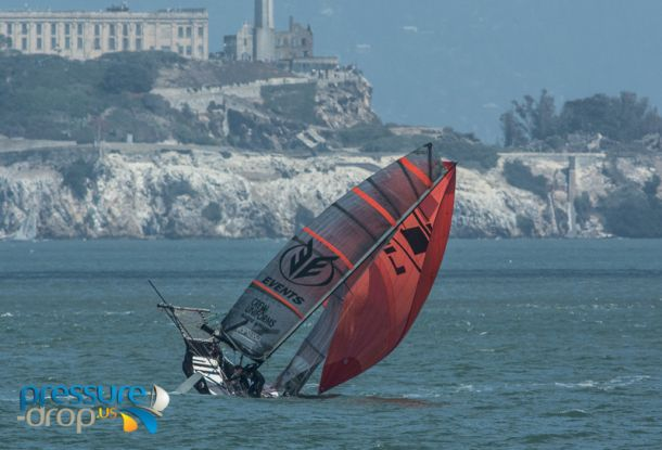 Over she goes! A difficult day of racing on the second day of the San Francisco 18ft Skiffs. Photo Erik Simonsen/Pressure Drop.
