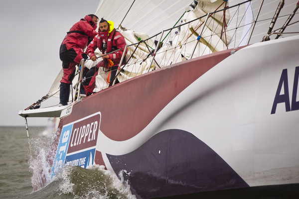On the bow of Great Britain in the Clipper Race. Photo Clipper Ventures.