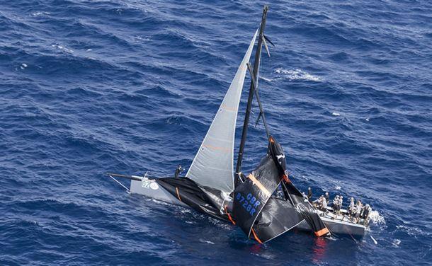 Alexander Schaerer's Caol Ila R with her broken mast. Photo ©: ROLEX / Carlo Borlenghi.