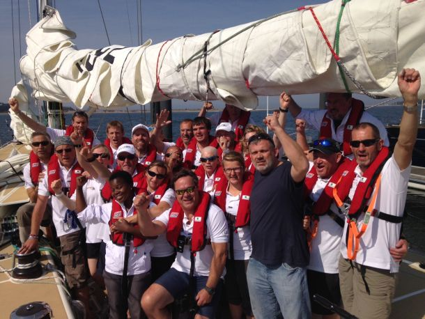 The crew of IchorCoal signals their return to racing. Photo Clipper Ventures.