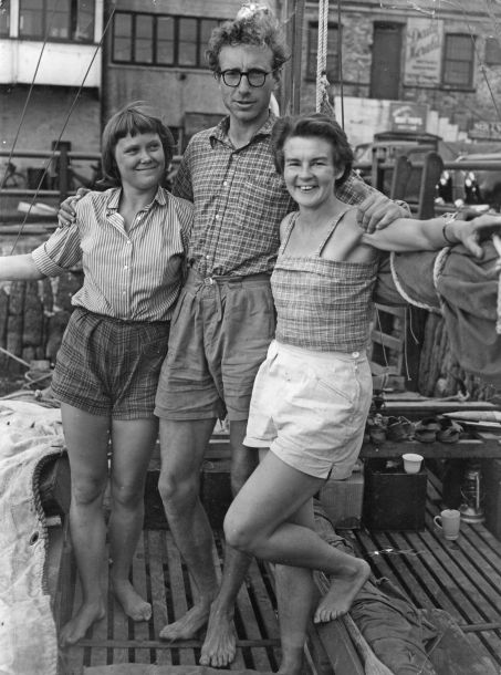 James Wharram poses with his two German crew (Jutta and Ruth) before departing in 1955.