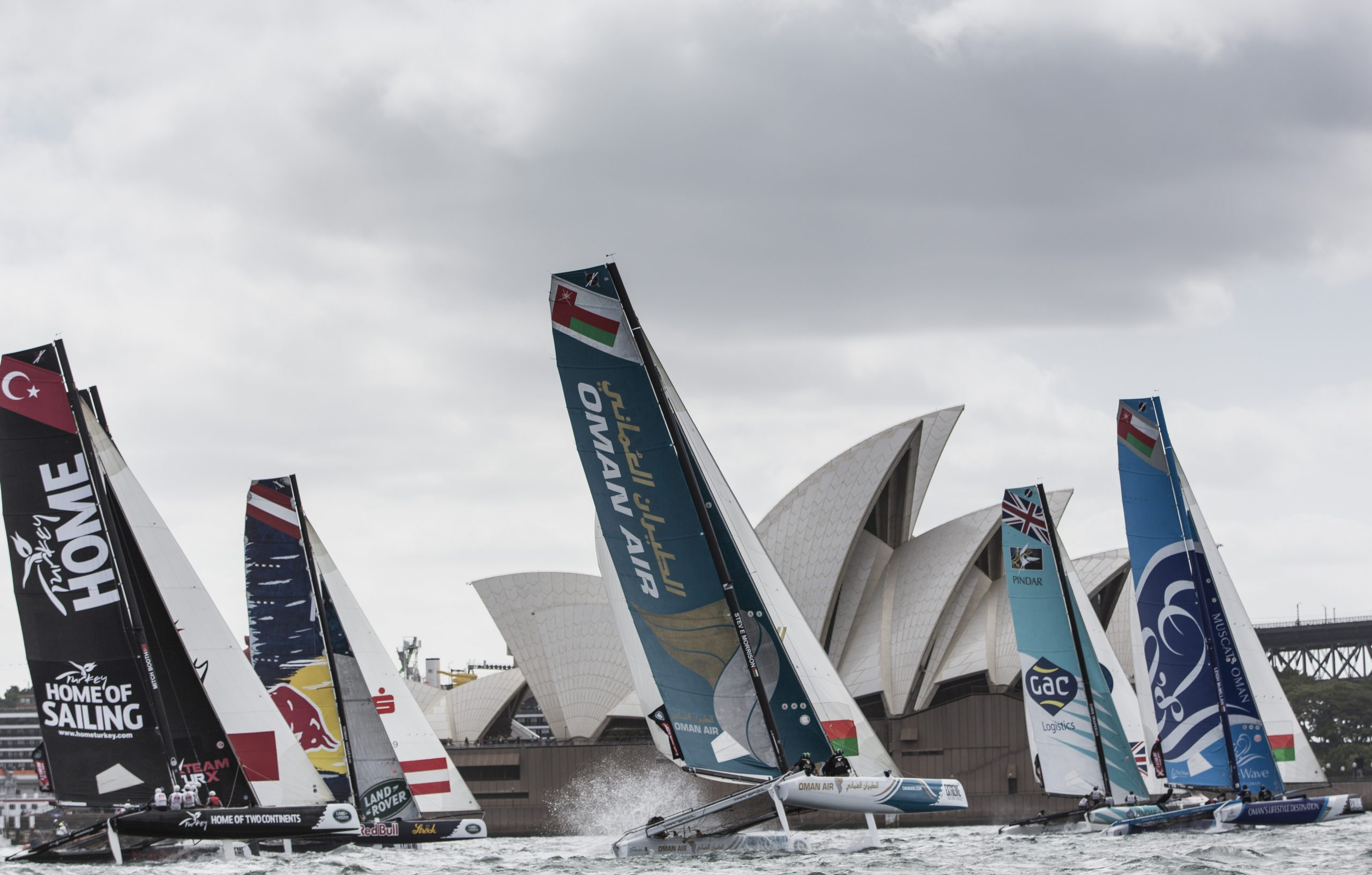 The fleet charge downwind against the backdrop of the Sydney Opera House. Photo Lloyd Images.