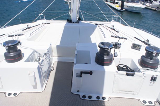 Plenty of room forward of the steering bridge for lounging and working the halyards and sheets.