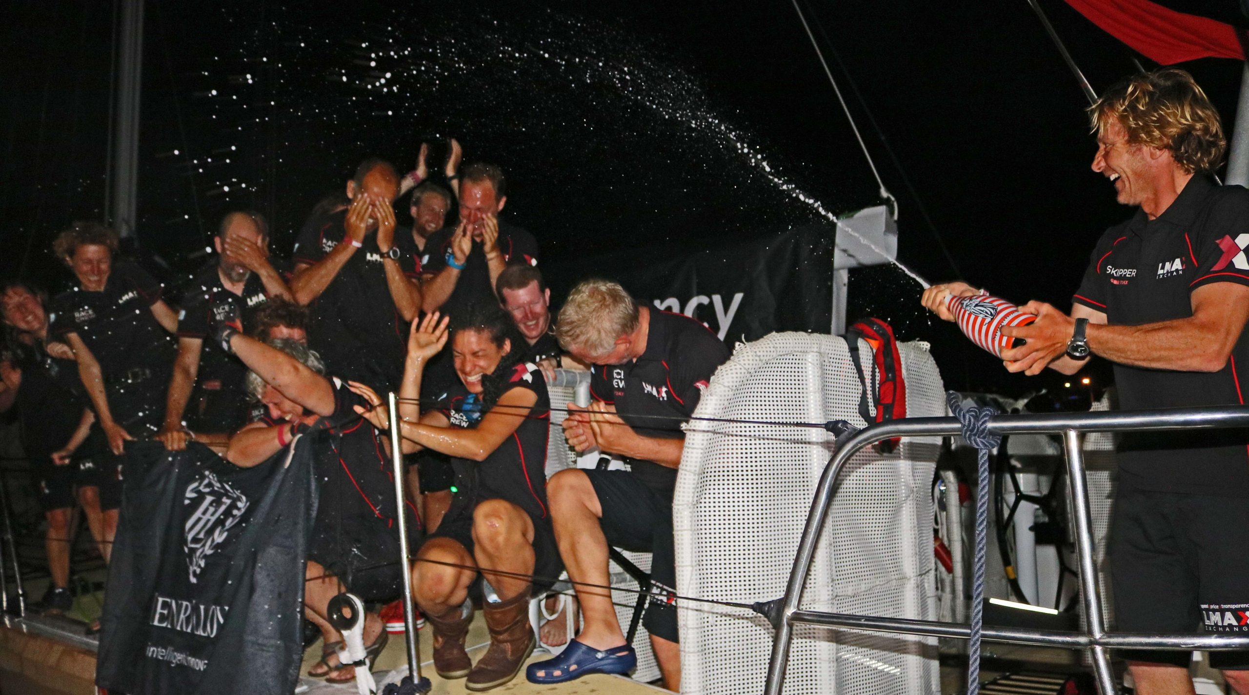 The crew of LMAX Exchange celebrate their victory in Airlie Beach. Photo Clipper Ventures.