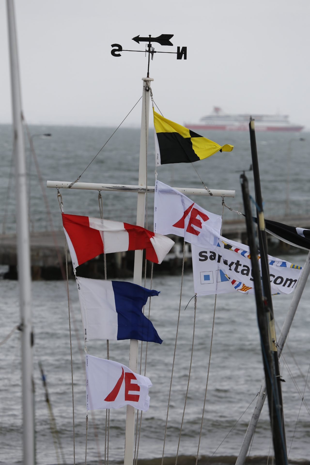AP over A and sponsor flags fly in the brisk breeze. Image courtesy Kylie Wilson/positiveimage.com.au