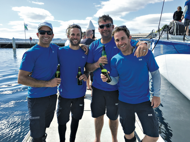 Some of the Ragamuffin 100 crew celebrate reaching Hobart with a cold beer.