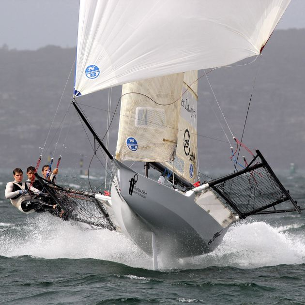 Trent David and Michael are airborne in a recent JJ Giltinan Championship Race. Photo 18 Footers League.