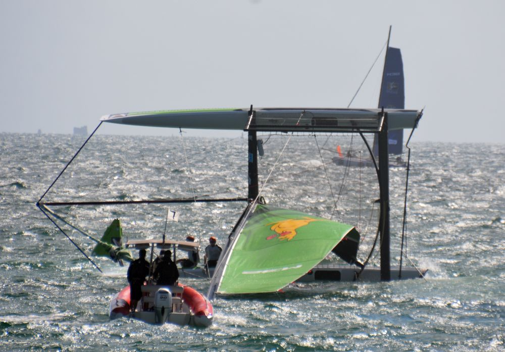 Jaochem Aschenbrenner and his Danish crew in the water after a capsize. Photo Roger McMillan.