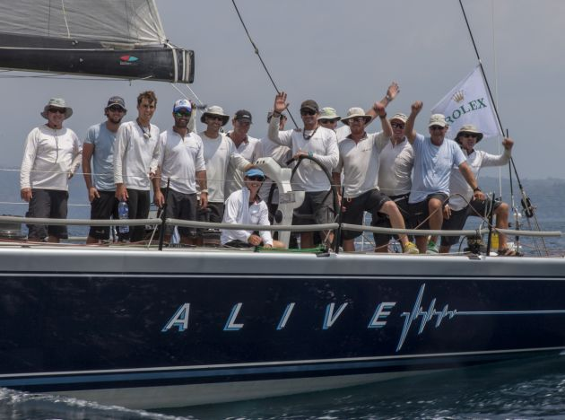The happy Alive crew at the finish. Image : Rolex / Daniel Forster.