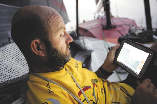 Ian Walker using a deck screen during the Volvo Ocean Race. Photo Matt Knighton/Abu Dhabi Ocean Racing/VOR.