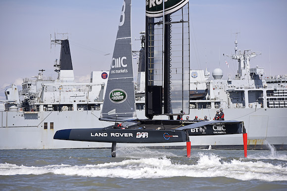 T3 takes flight past the Royal Navy's HMS Bulwark (c) Rick Tomlinson / Land Rover BAR.