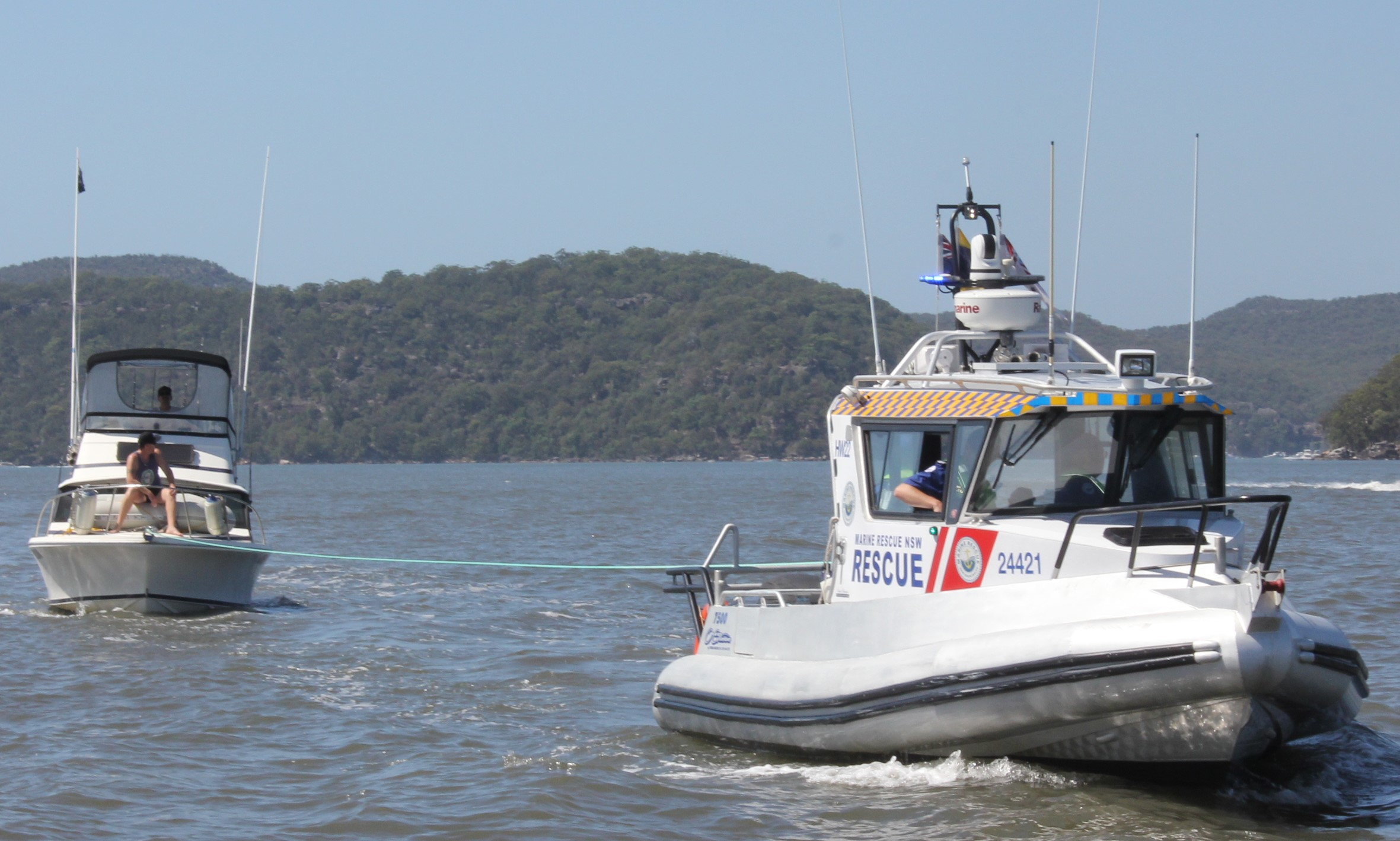 NSW Marine Rescue carries out a rescue tow of a powerboat. (Should get a yacht).