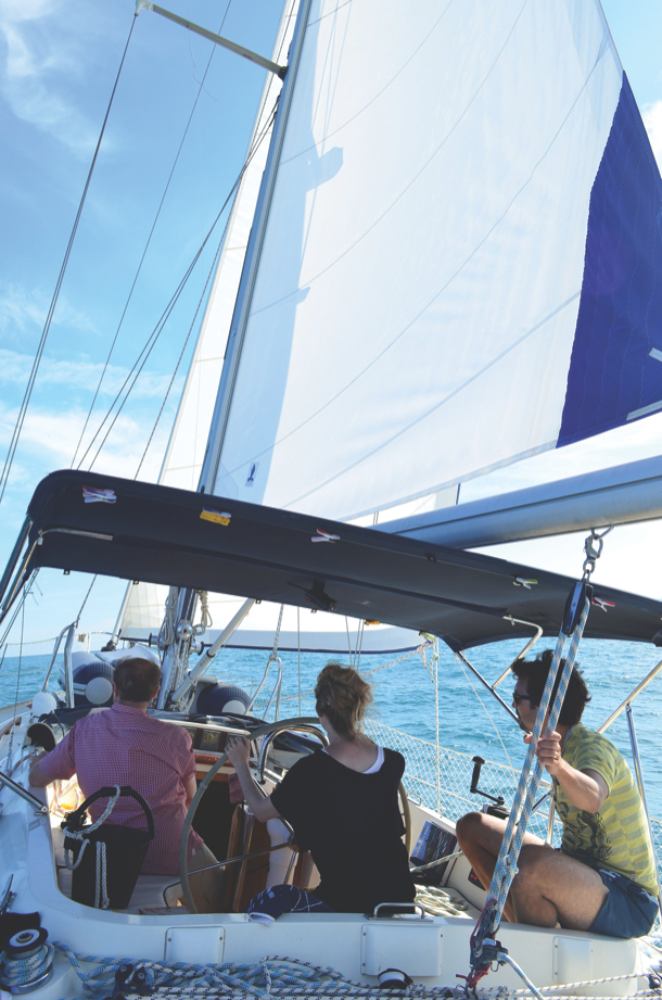 Friends on board for perfect day sail in light breeze - excellent sailing performance