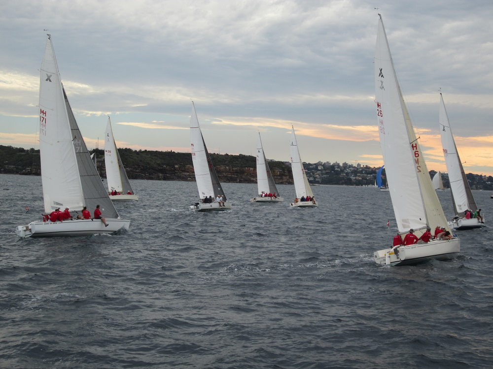 Fleet racing in the dying light. MHYC red shirts clearly visible.