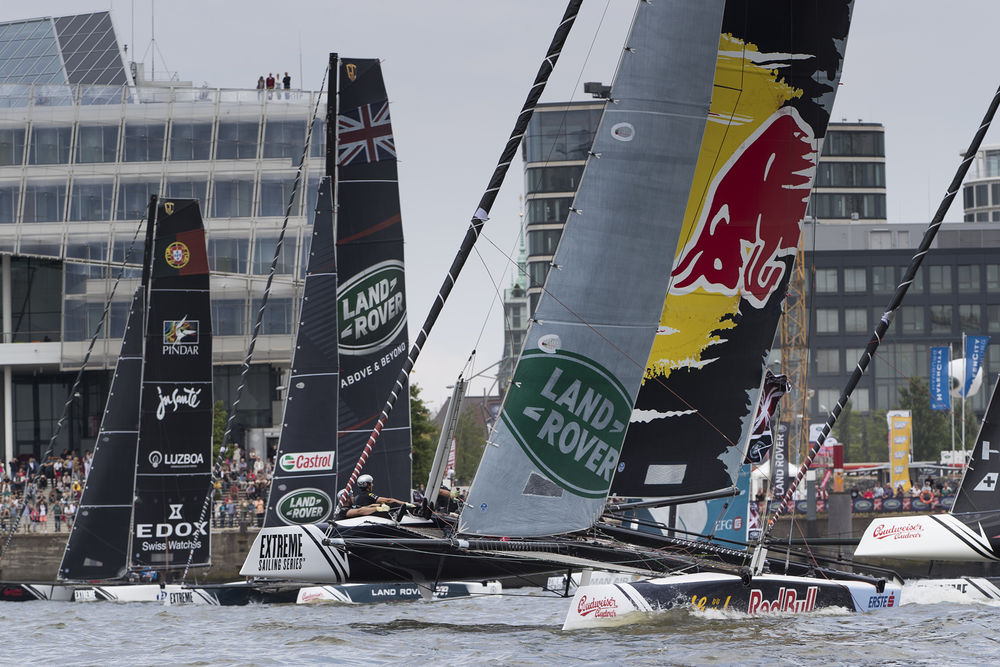 Red Bull Sailing Team lead the fleet as they battle on Hamburg's River Elbe. Photo Lloyd Images.