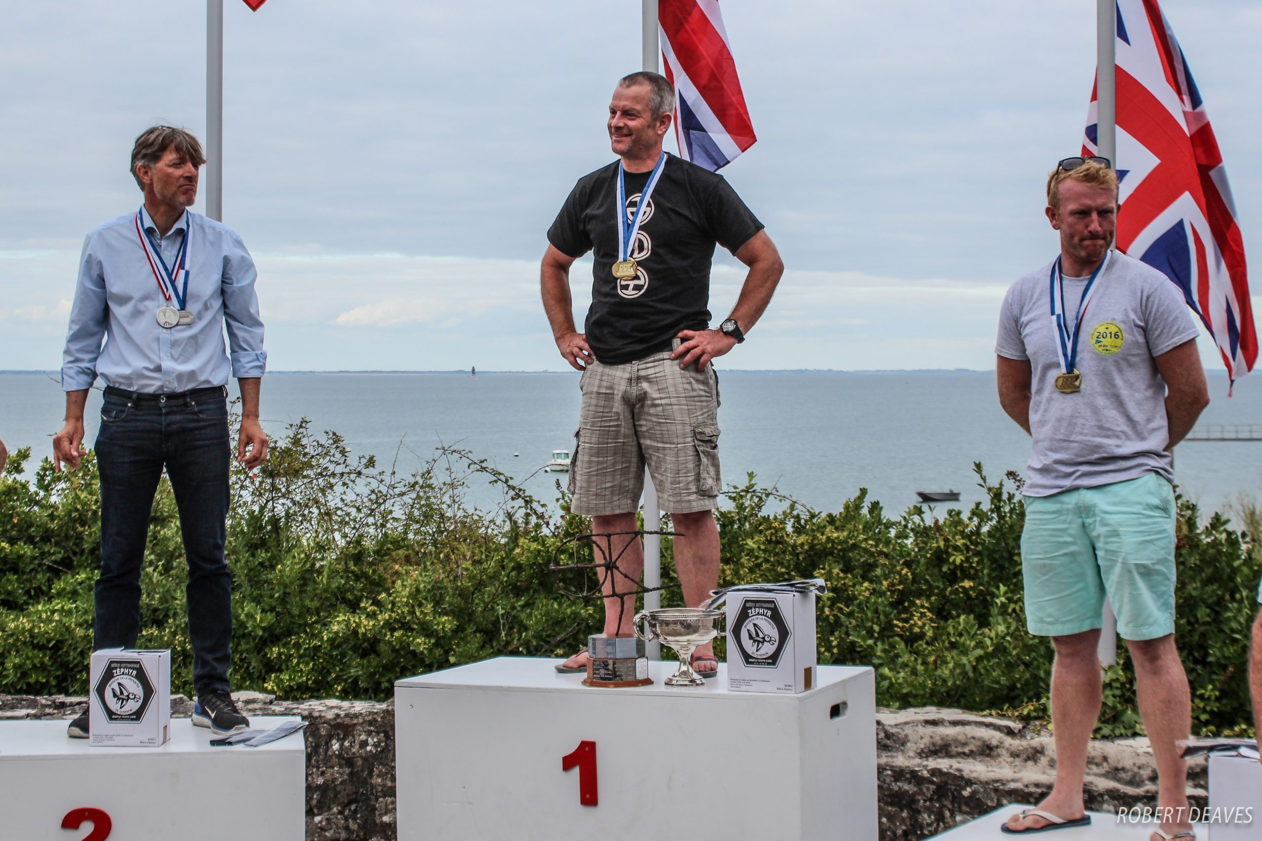 Jim Hunt at the top of the OK Dinghy podium for the second time. Photo Robert Deaves.