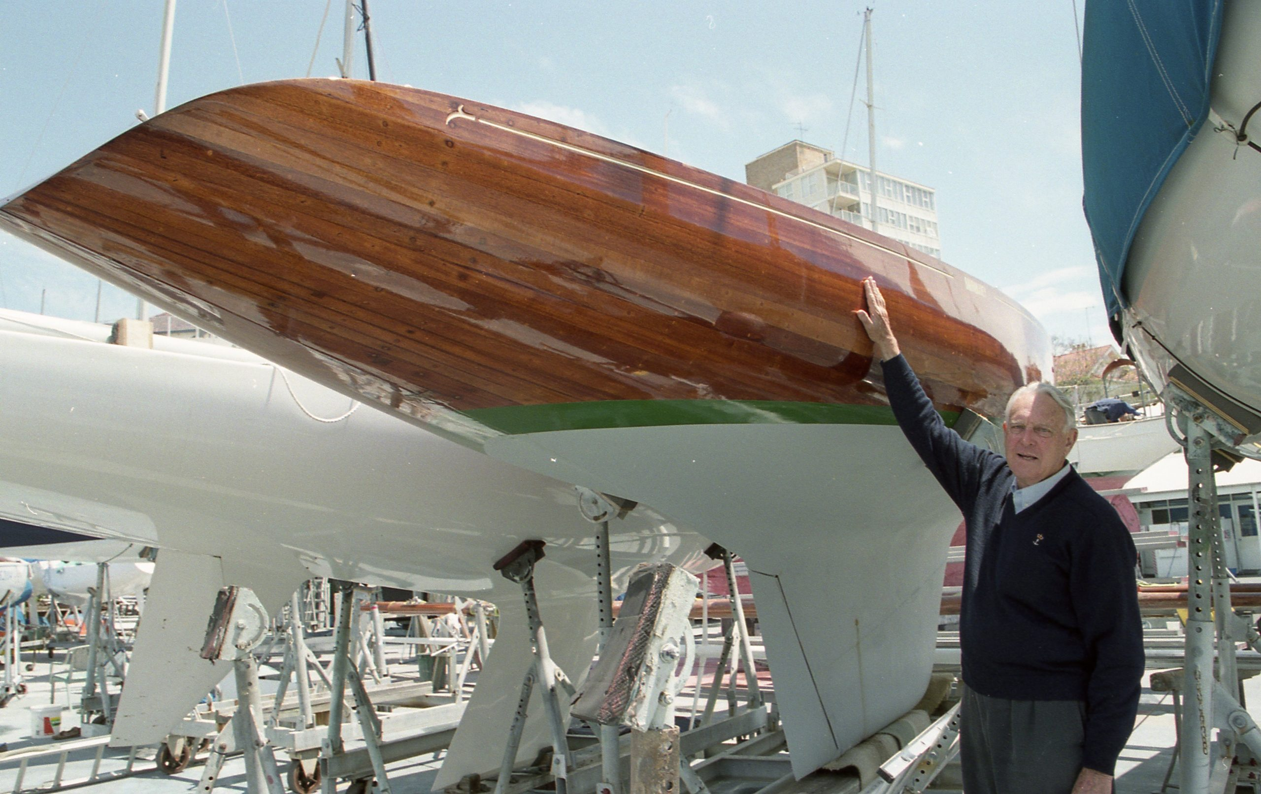 Bill Solomons with the restored Barranjoey in 2004.  Photo Bob Ross.