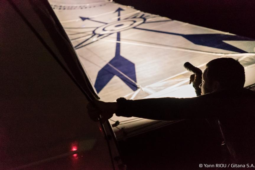 Checking sail trim at night. Photo Jann Riou/Gitana.