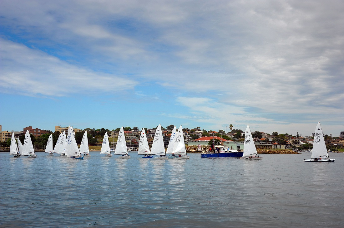 OK Dinghies commence Bill Tyler sail past. Photo Bruce Kerridge.
