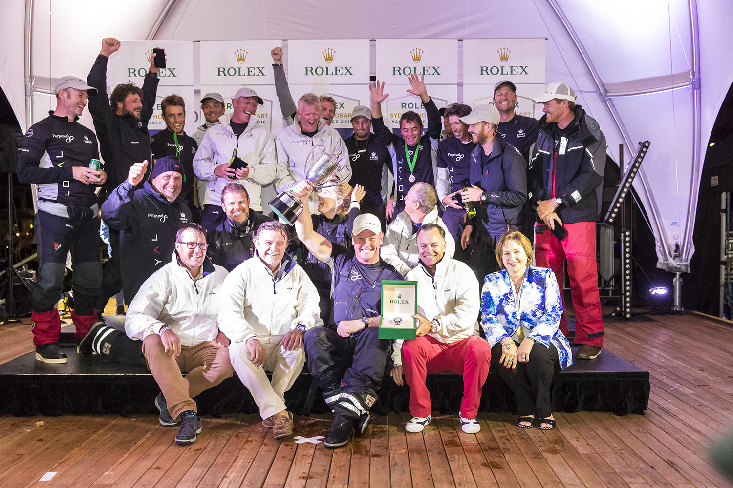 The crew of Perpetual Loyal celebrate their victory. Photo Andrea Francolini.
