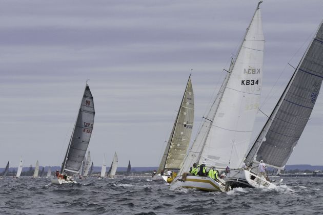A string of cruiser racers make their way towards the Busselton Jetty in race one. Photo Bernie Kaaks.