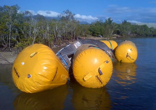 Lifting a derelict vessel with dive airbags. Photo Maritime Safety Queensland.