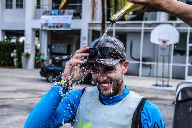 Evan Walker gets the traditional winner's champagne shower. Photo WMRT/Lloyd Images.
