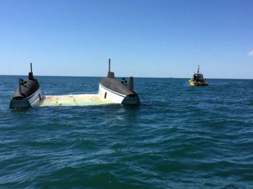 The capsized catamaran. Photo TradeOnlyToday.