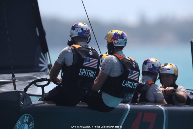Jimmy Spithill and Kyle Langford discuss the damage to their wing. Photo Gilles Martin Raget/Oracle Team USA/ACEA.