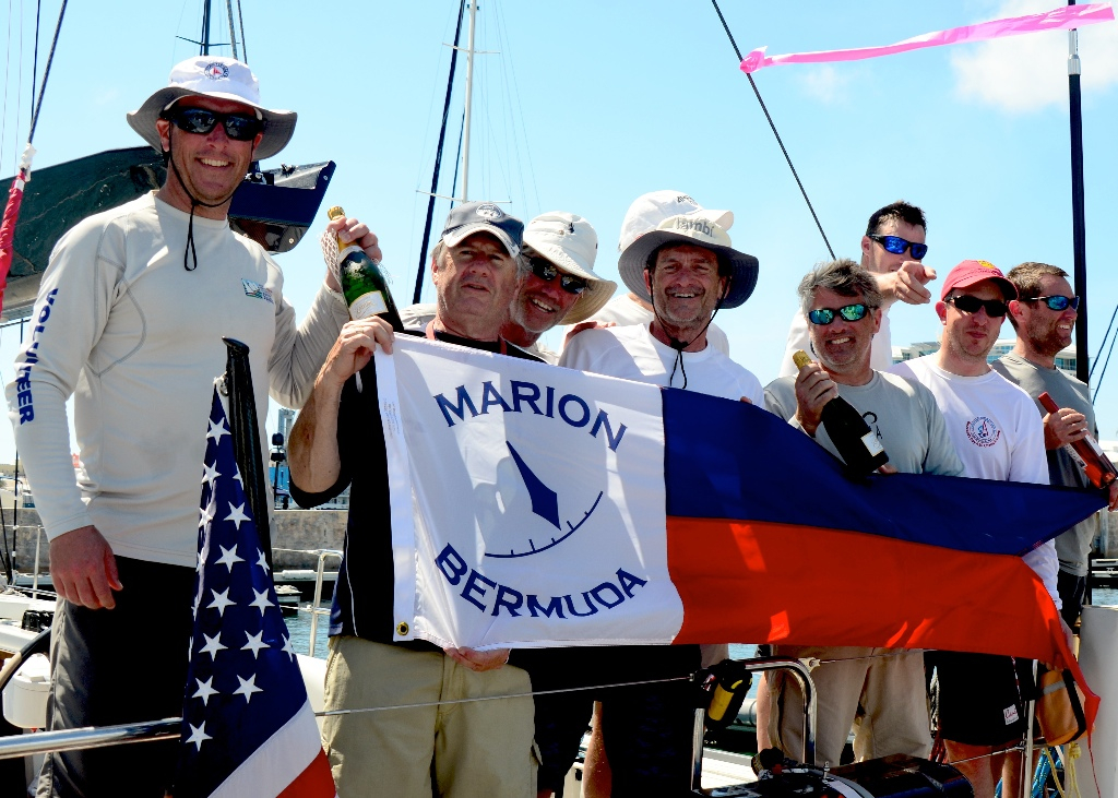 John Levinson (Center) and crew show off their Line Honors banner at the Royal Hamilton Amateur Dinghy Club. Photo Talbot Wilson.