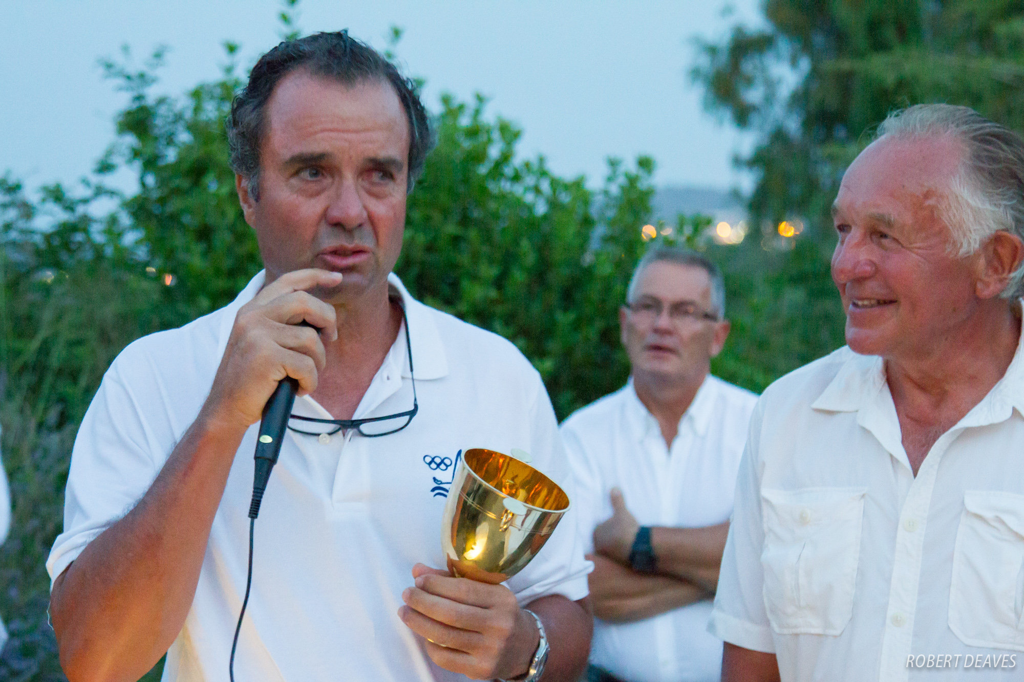 Joaquín Blanco receives the Finn Gold Cup from Finn Class President of Honour Gerardo Seeliger. Photo Robert Deaves.