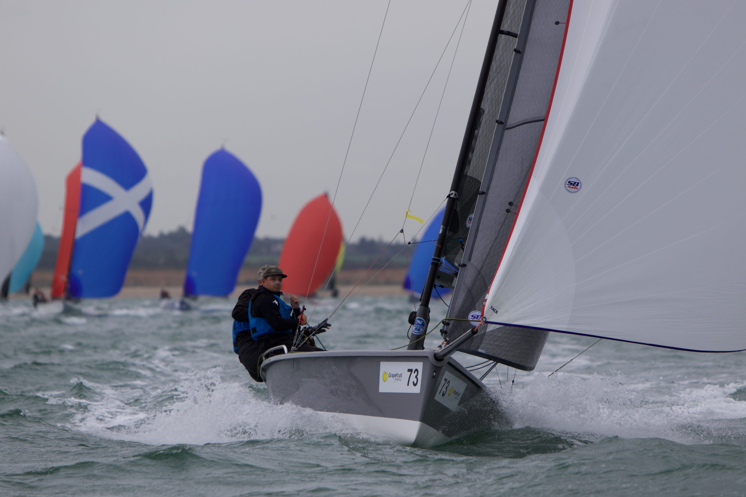 Overall leader Export Roo powers downwind to victory on day three of the SB20 worlds. Photo Jennifer Burgis.