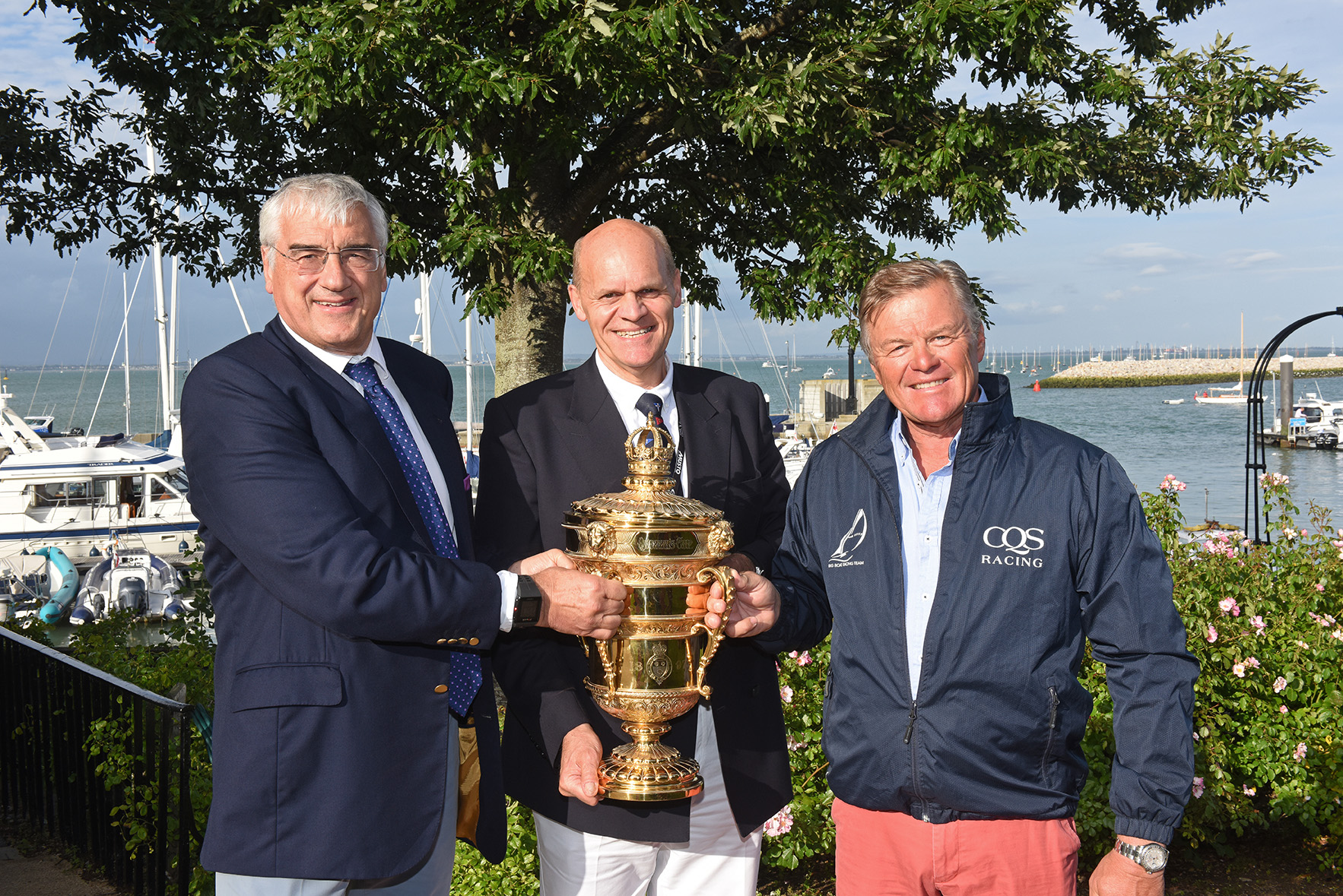 Sir-Michael-Hintze-left-and-Ludde-Ingvall-right-receive-the-Queens-Cup