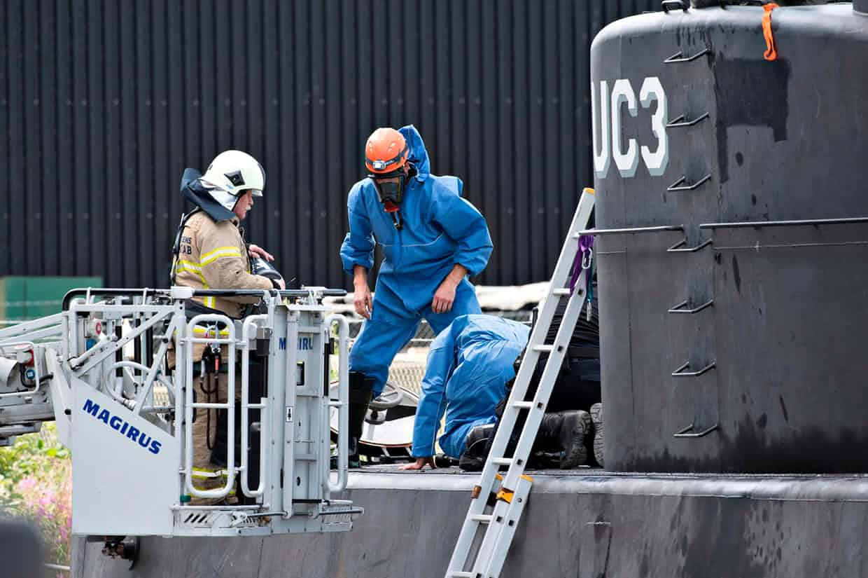 Police technicians investigating Nautilus submarine after Kim Wall's disappearance. Photograph: Jens Noergaard Larsen/AFP/Getty Images