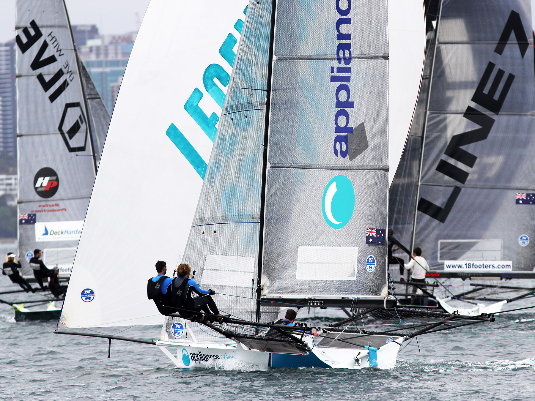 Racing was tight at the first windward mark. Photo 18 Footers League.