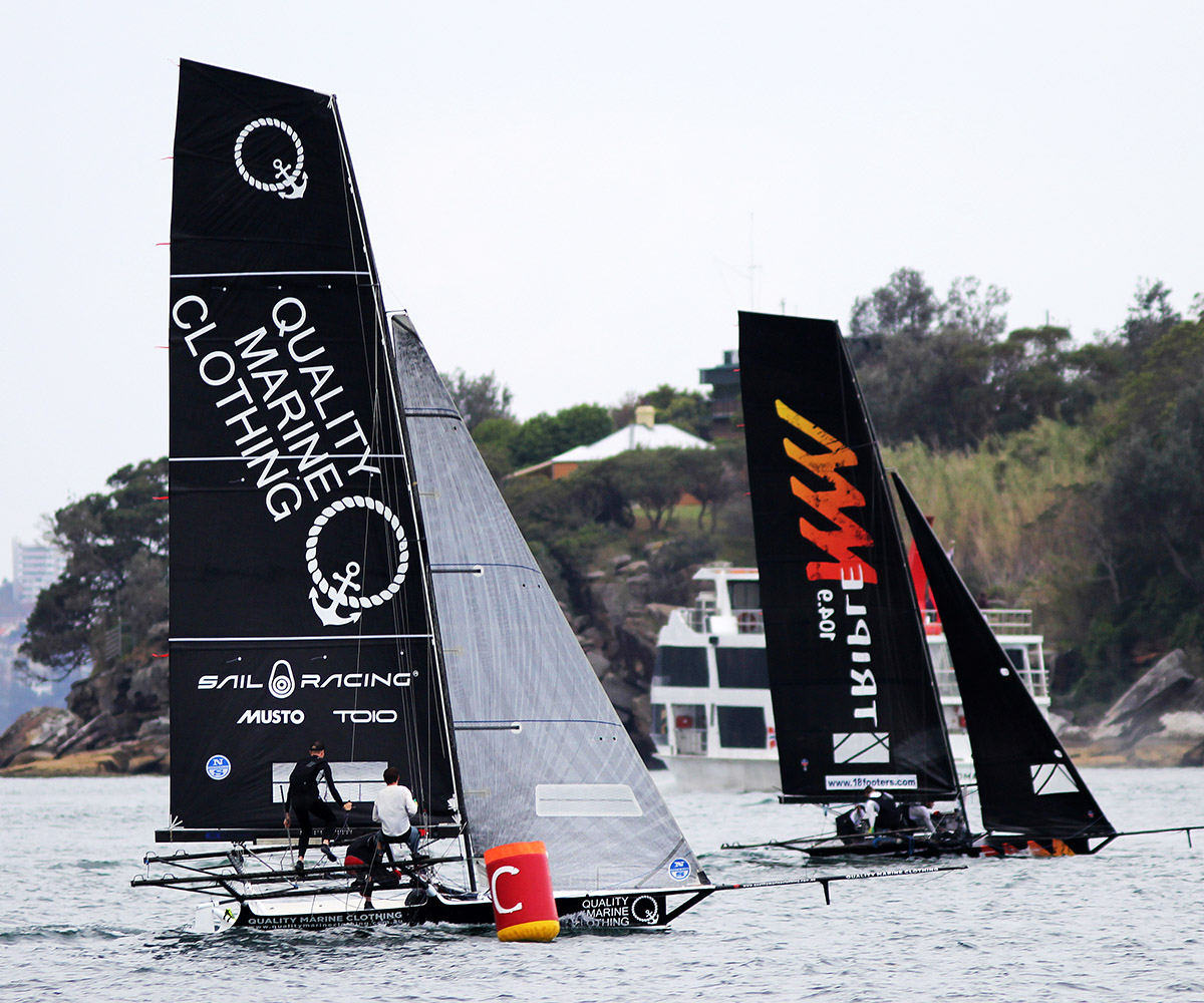 Quality Marine Clothing grabbed the lead for the first time at the Rose Bay windward buoy. Photo Frank Quealey.