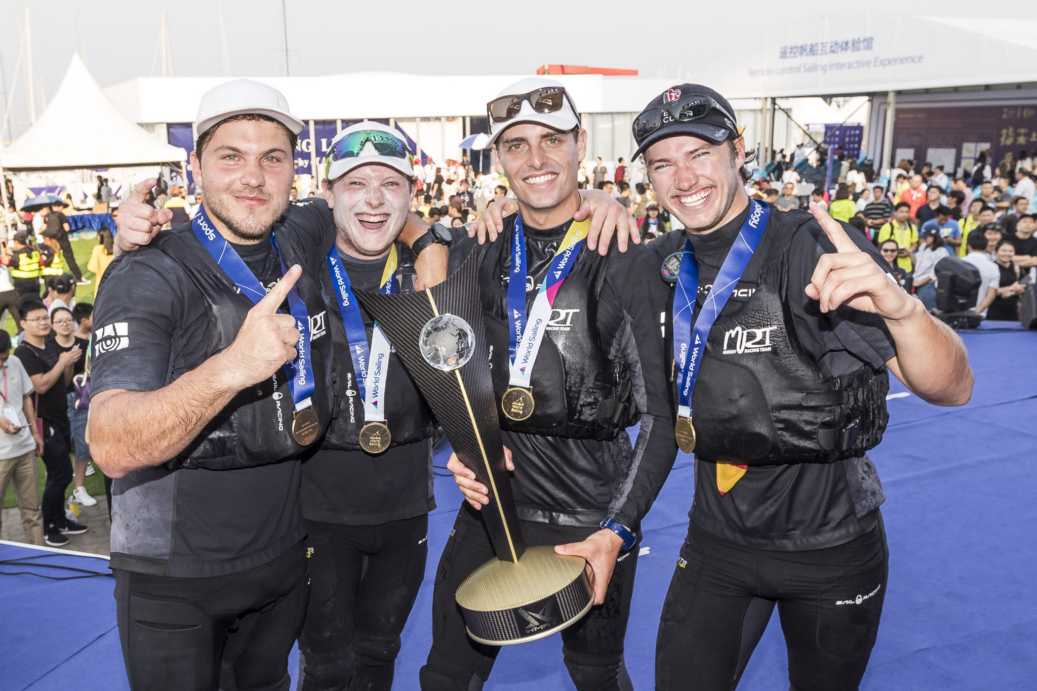 Torvar Mirsky (second from right) and his crew celebrate their world championship. Photo Lloyd Images.