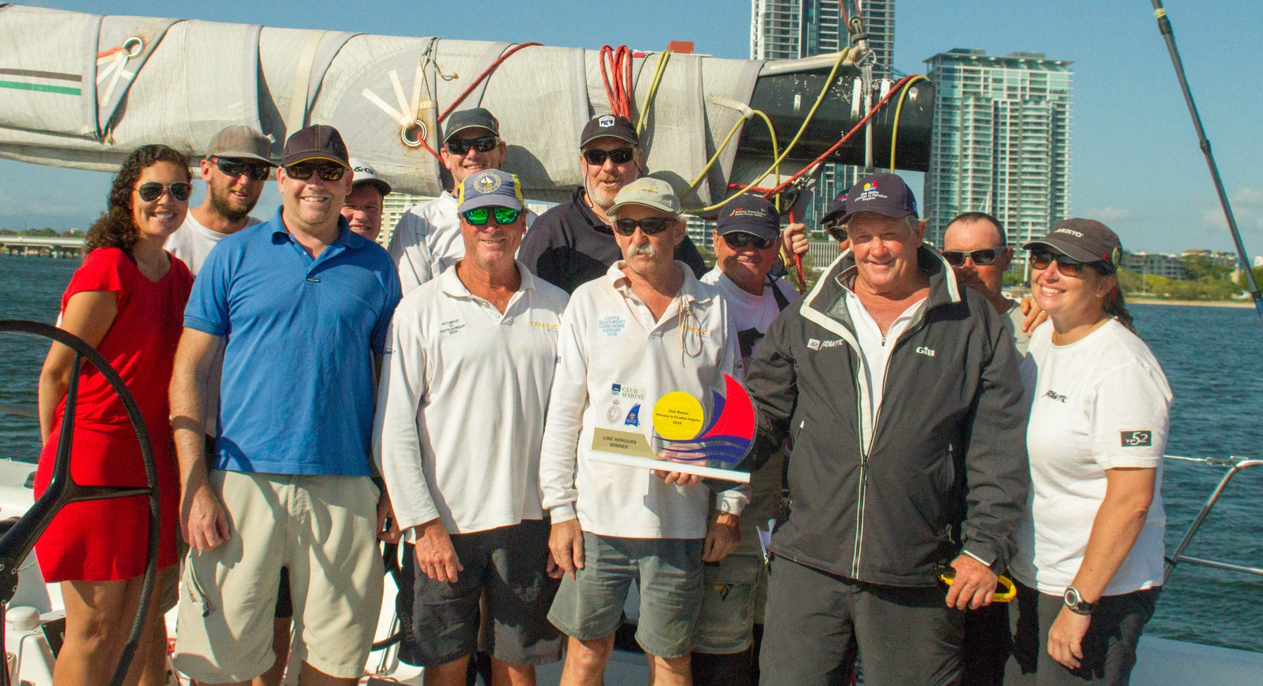 The Frantic crew with their line honours trophy. Photo Beth Moreley.