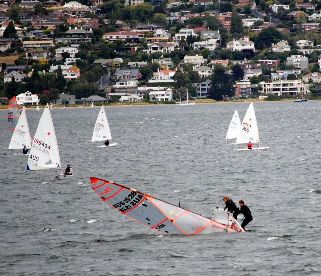 Strong gusts saw many capsizes in the Crown Series Bellerive Regatta racing on Saturday. Photo Jane Austin.