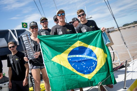 Nina Curtis (with trophy) and her Brunel yteam mates celebrate their win in leg 7 of the Volvo Ocean Race. Photo Ainhoa Sanchez / Volvo Ocean Race.