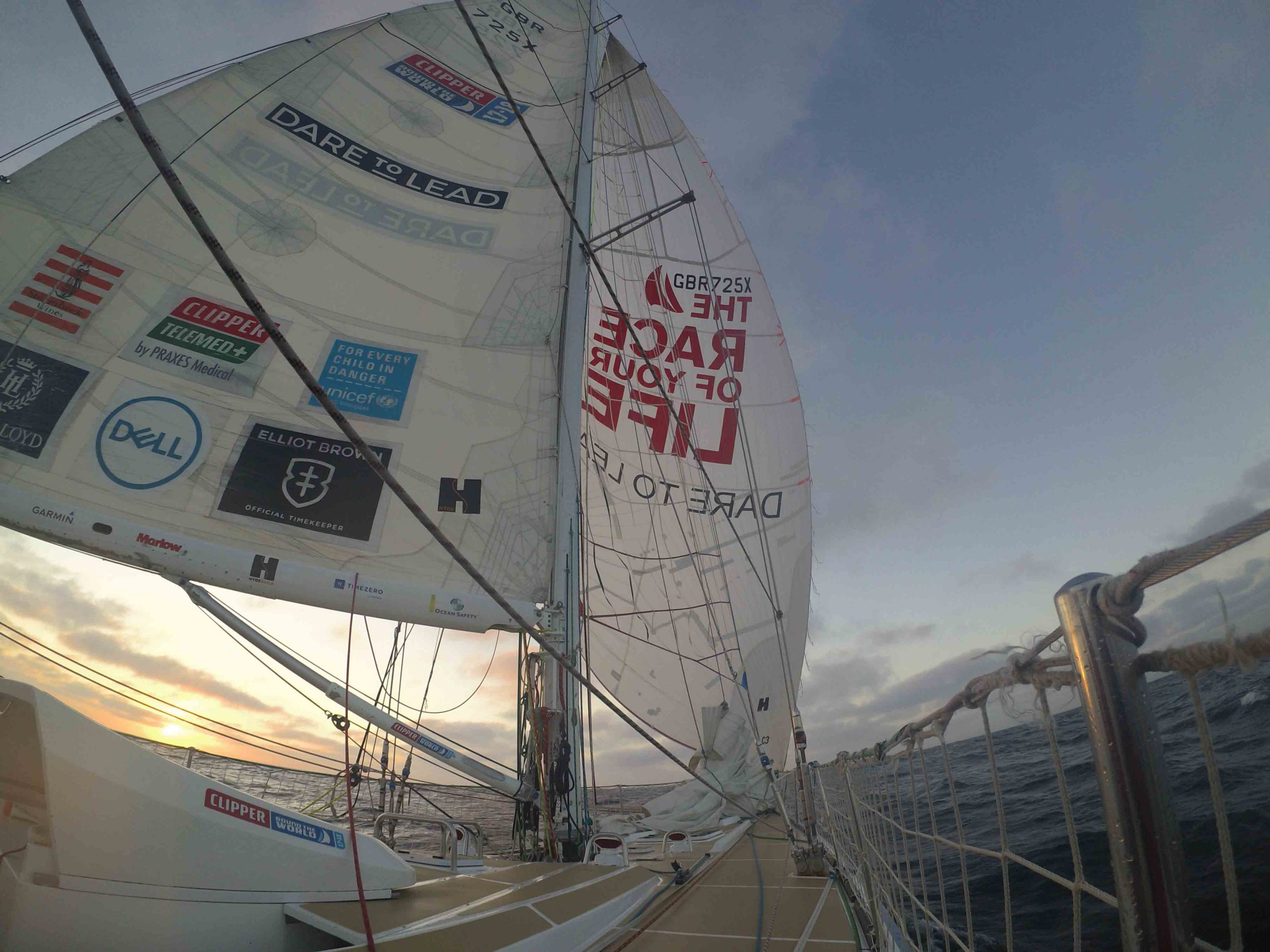 Dare to Lead flying Code 2 kite at sunrise - Clipper Race pic